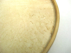 Samba batucada surdo drum head made of goat skin wrapped around a wooden hoop.