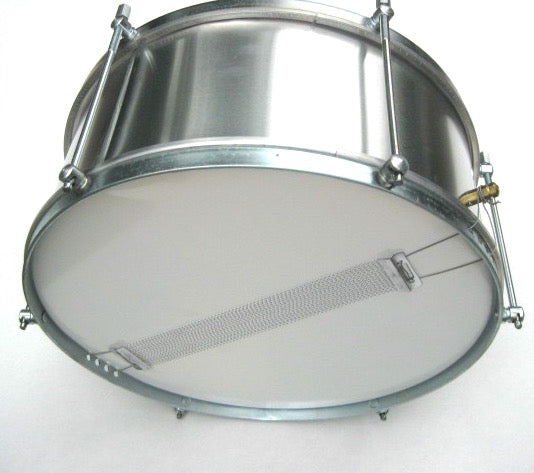 Aluminum snare drum used in samba reggae and maracatu. Brand is artcelsior. Silver drum shell and silver hardware setting on it's side.