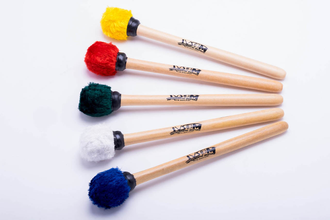 First and second surdo mallets, primera mallets in multiple colors. Wooden handles and fuzzy head mallets.