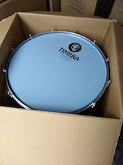 Timbra surdo in a shipping box. Timbra logo on the drum head.