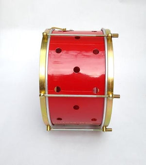 Side view of a Brazilian with brass colored hardware, six strings, clear drum heads and a red shell. The primary red shell has small holes drilled into it.