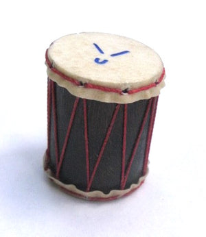 Tiny hand made Brazilian shaker with goat skin heads and red strings.