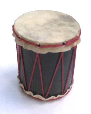 Teeny drum shaker from Brazil. Goat skin heads and red strings.