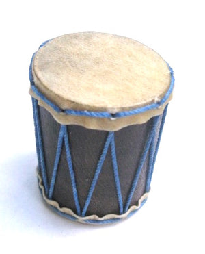 Tiny pagode hand made shaker. Goat skin heads and blue strings. White background.