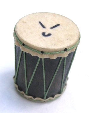 Small drum shaped shaker that has goat skin heads and green strings on a dark wooden shell. White background.