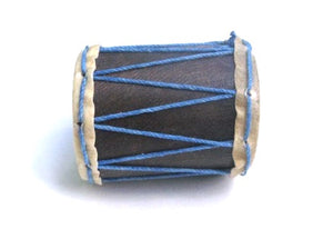 Little drum shaker on it's side. Hand sewn goat skin heads with blue strings.