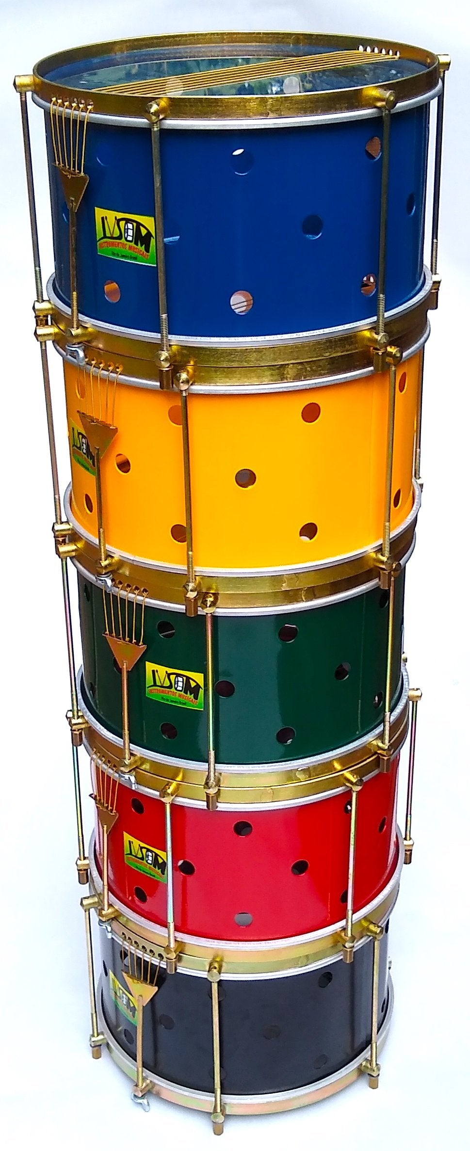 Multiple colors stack of drums! IVSOM drums called caixas stacked with brass colored hardware, six strings, clear dum heads and a powder coated shell. The drum shell has small holes drilled into it.