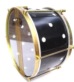 Side view Brazilian instrument with brass colored hardware, six strings, clear drum heads and a black shell. The black has small holes drilled into it.
