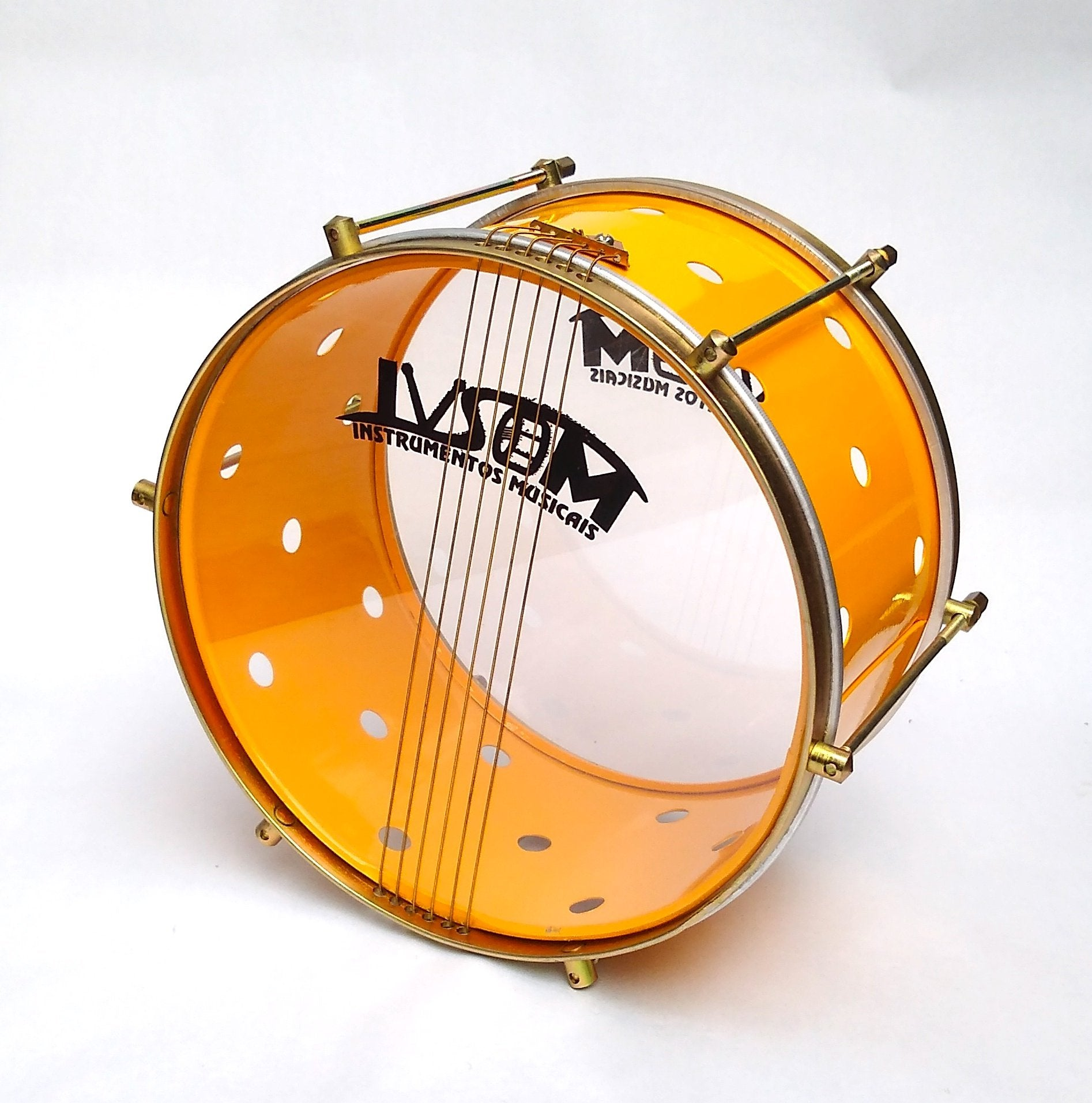 Yellow samba drum with brass colored hardware, six strings, clear drum heads and a yellow shell. The yellow shell has small holes drilled into it.