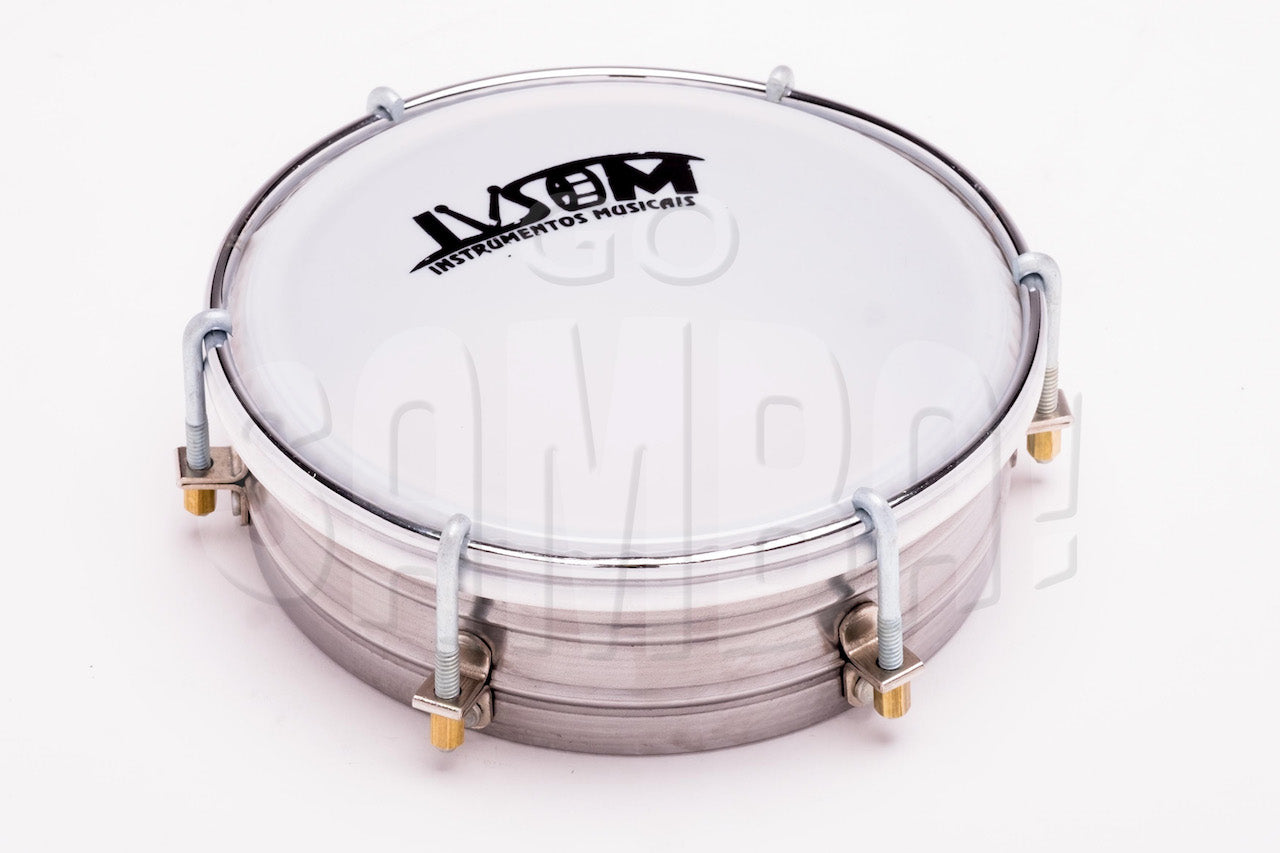 Steel tamborim by IVSOM. Steel shell and white plastic drum head on a white background.