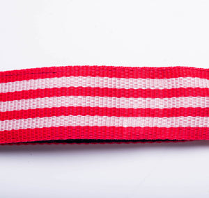 View of red and white samba strap material made by Macapart.