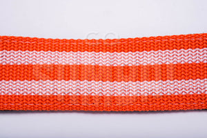 Orange and white material of a samba strap, on white background.