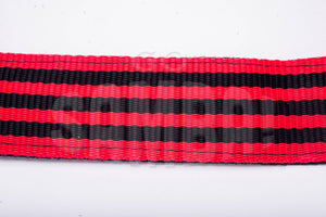 Black and red shoulder strap for samba caixa.