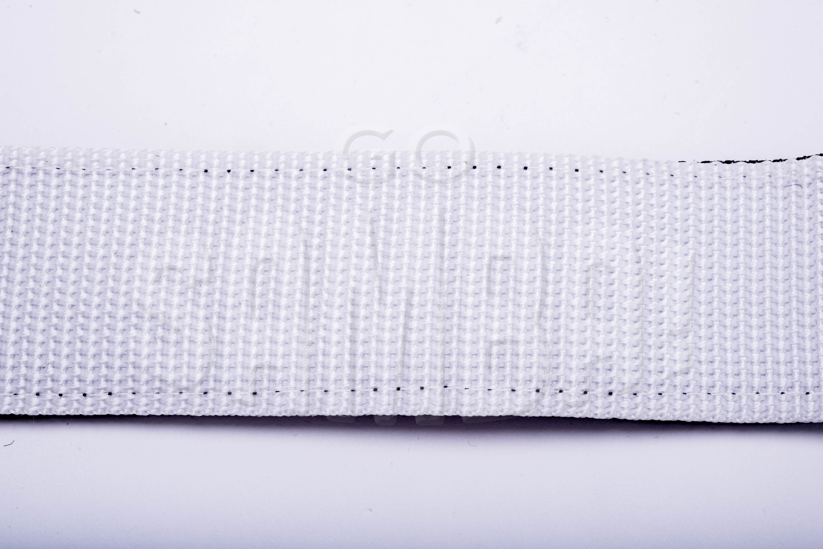 White strap on white background.