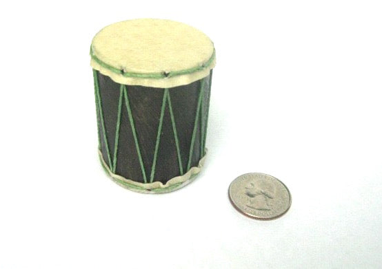 Tiny hand-made shaker that looks like a teeny drum with a quarter to compare the size. Goat skin heads and wood shell. Green strings.