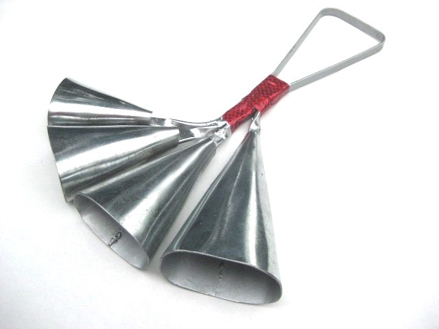 Quad bell,carbon steel with red taped handle. 4 bells on a white background.