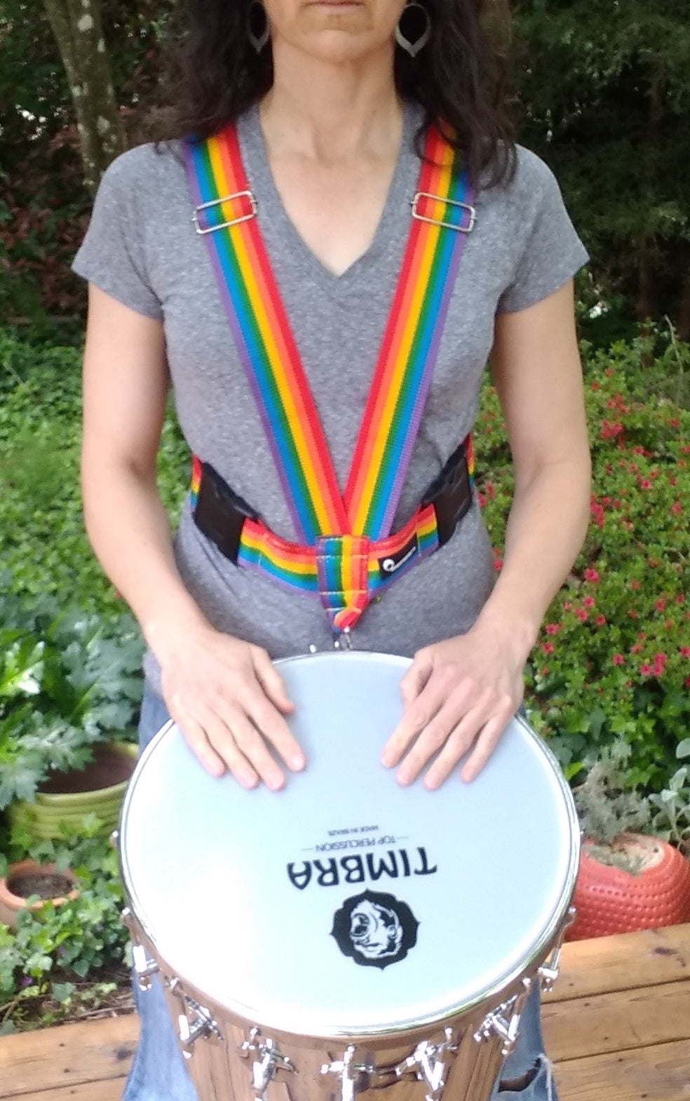 Front view of timbal strap, big buckles, rainbow colors by macapart. Timbra timbau with timbra logo.