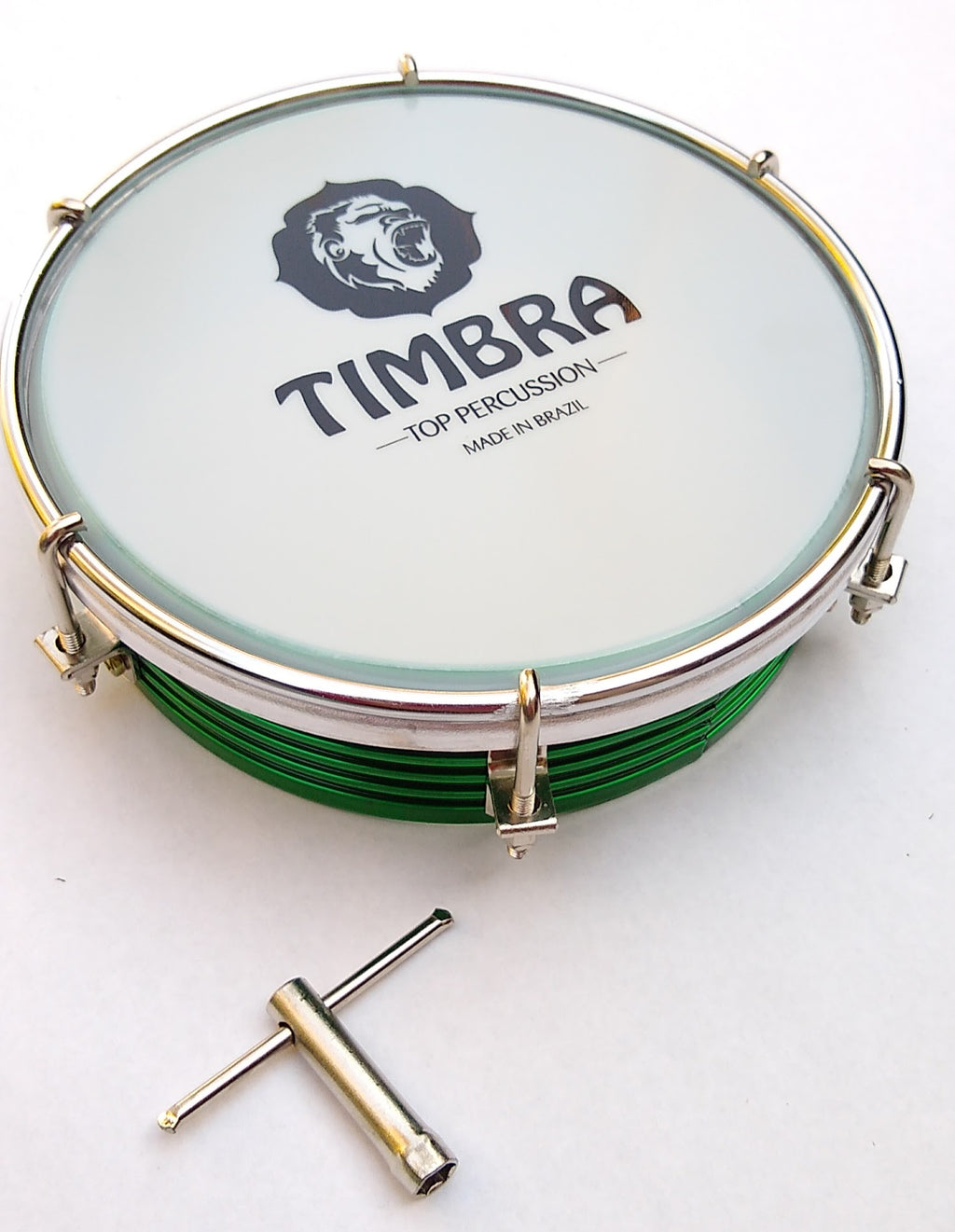 Green shell tamborim with a white head and Timbra logo. Silver drum key and hardware on a white background