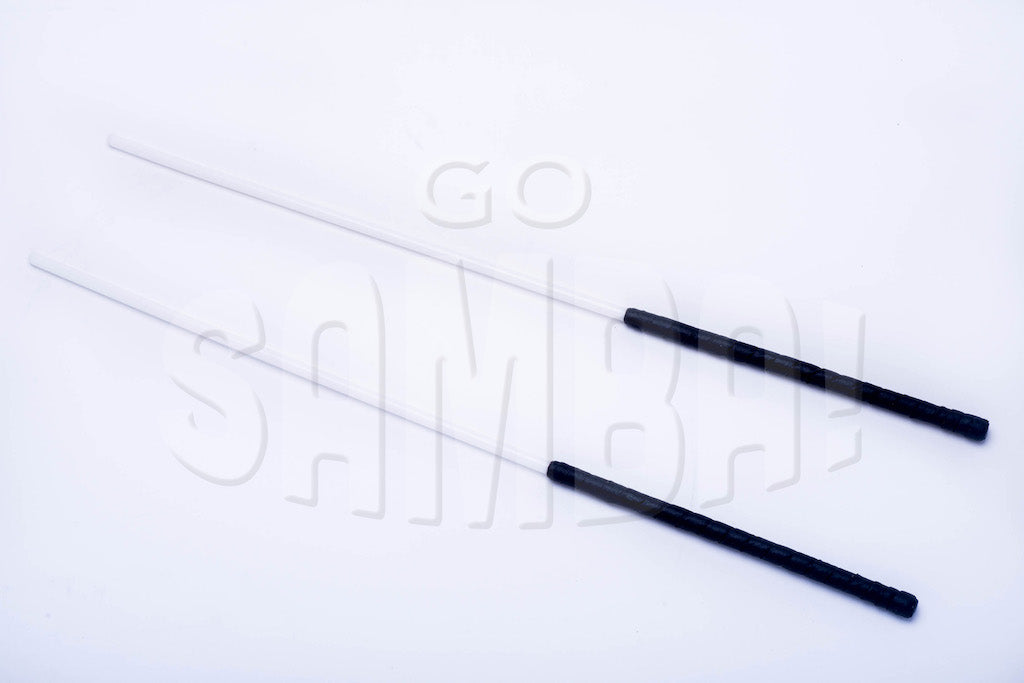 Two plastic whippy sticks with black handles on a white background.