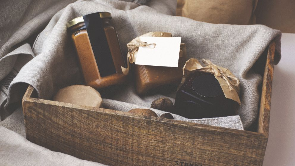 mason jars with gift tags in a wooden box