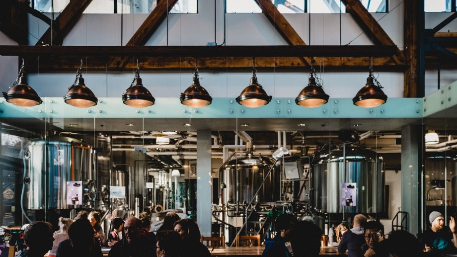 people enjoying craft beer at a busy brewery