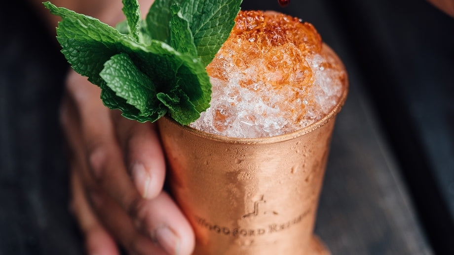 icy cocktail in a copper cup with sprigs of mint