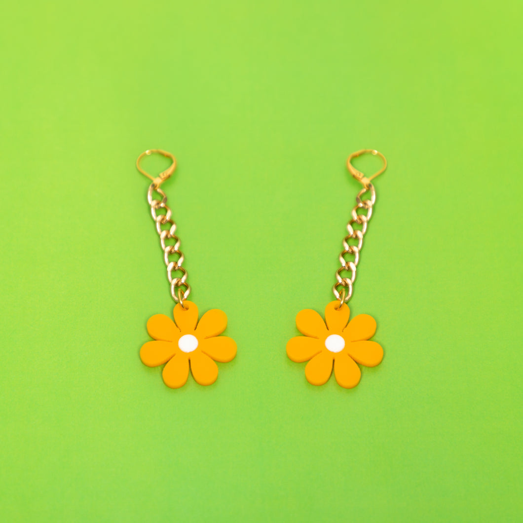 The Baby Daisy Chain Earrings: Gold chain and canary daisy.