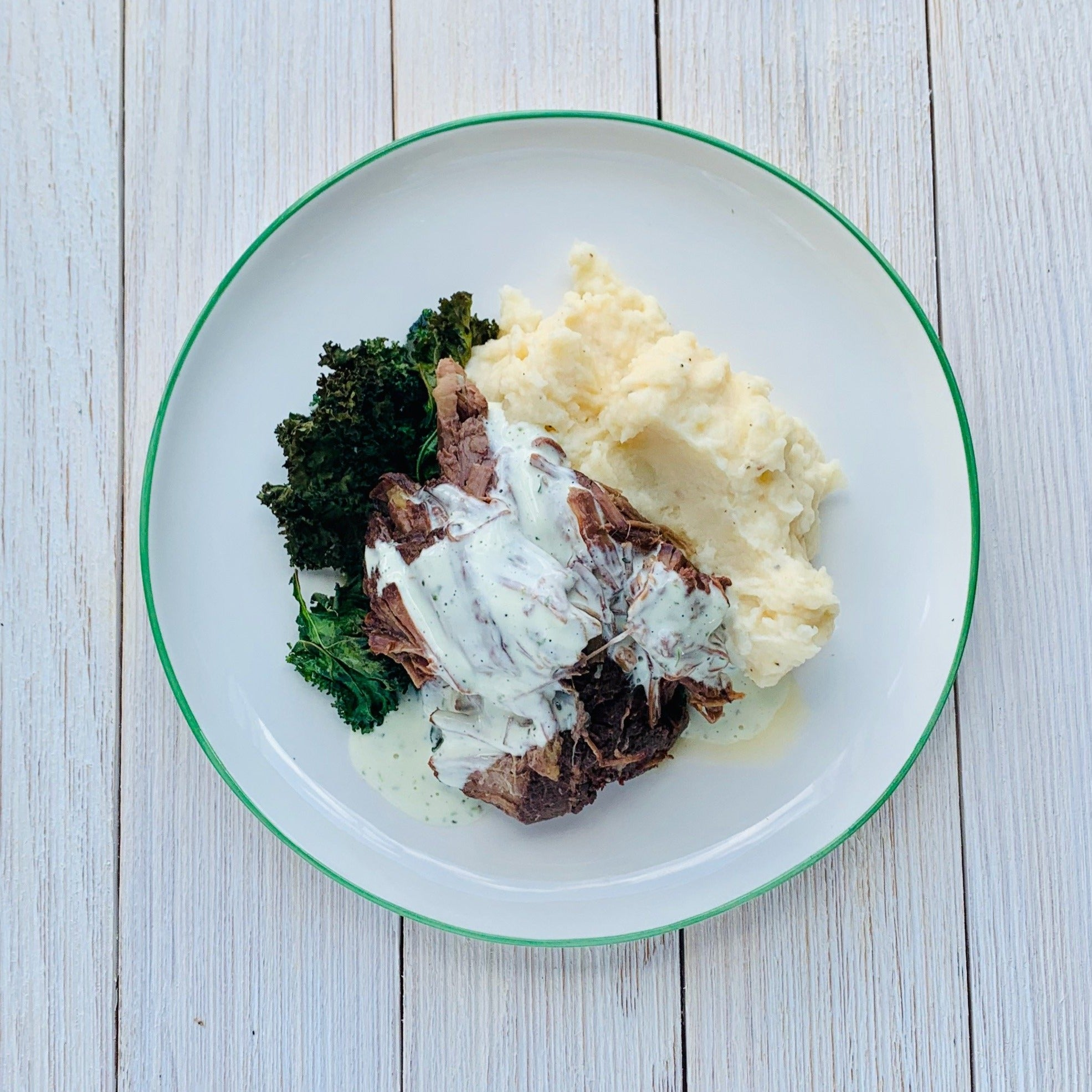 Braised Beef with Bearnaise Sauce, Toasted Kale & Garlic-Cheddar Mashed Potatoes (GF)