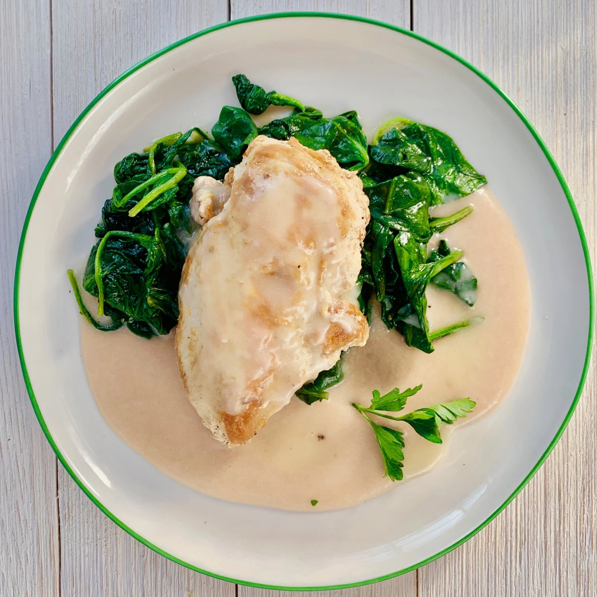 Chicken with 40 Cloves of Garlic Sauce, White Bean Puree and Wilted Greens