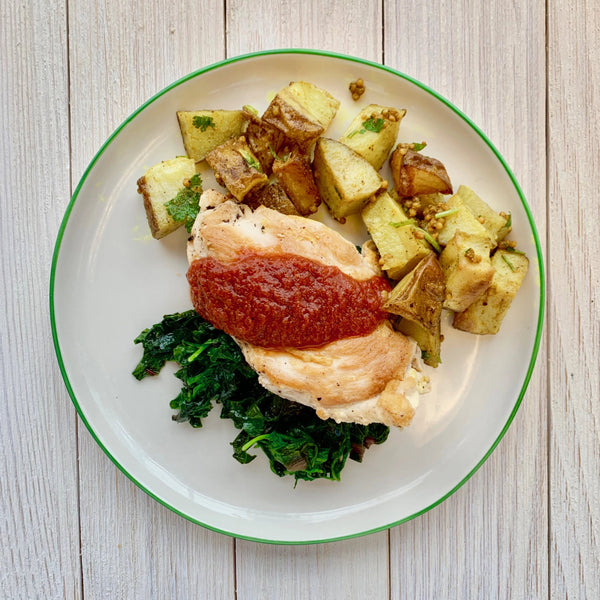 Chicken with Harissa Sauce, Wilted Chard & Mustard Seed Roasted Potatoes