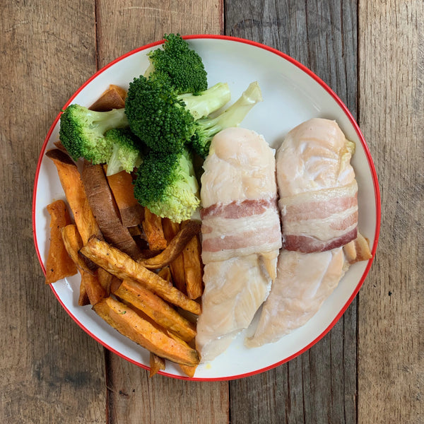 Bacon Wrapped Chicken Tenders with Garlic Cream, Broccoli & Sweet Potato Fries