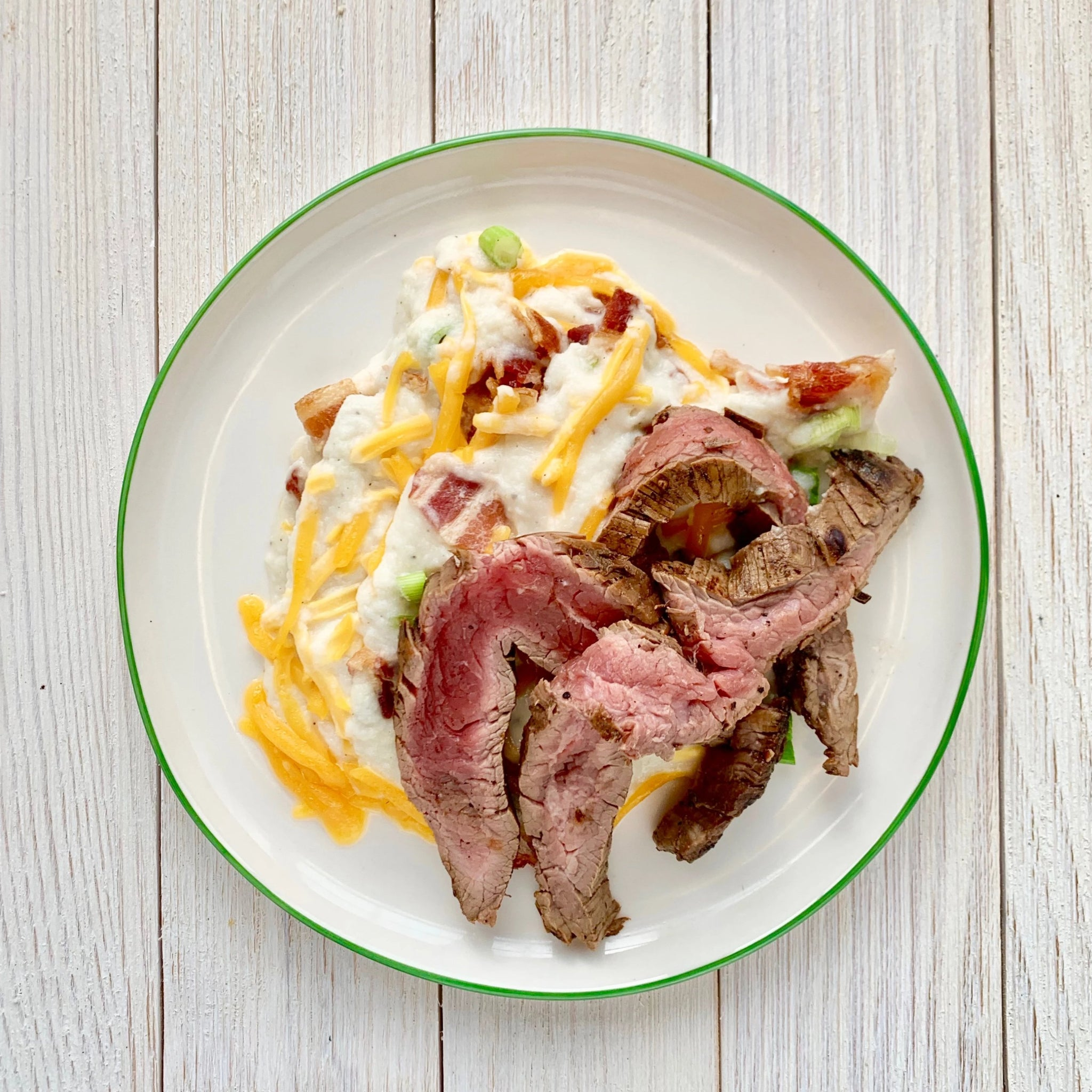 Marinated Flank Steak over Loaded Mashed Cauliflower