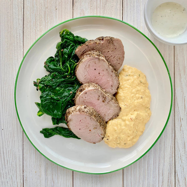 Pepper Crusted Pork Tenderloin with Herb Cream, Wilted Spinach and Corn Maque Choux