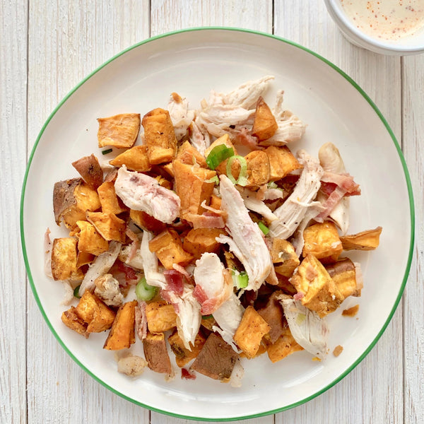 Roasted Sweet Potato Bowl with Smoked Chicken, Bacon, Green Onions and White BBQ Sauce