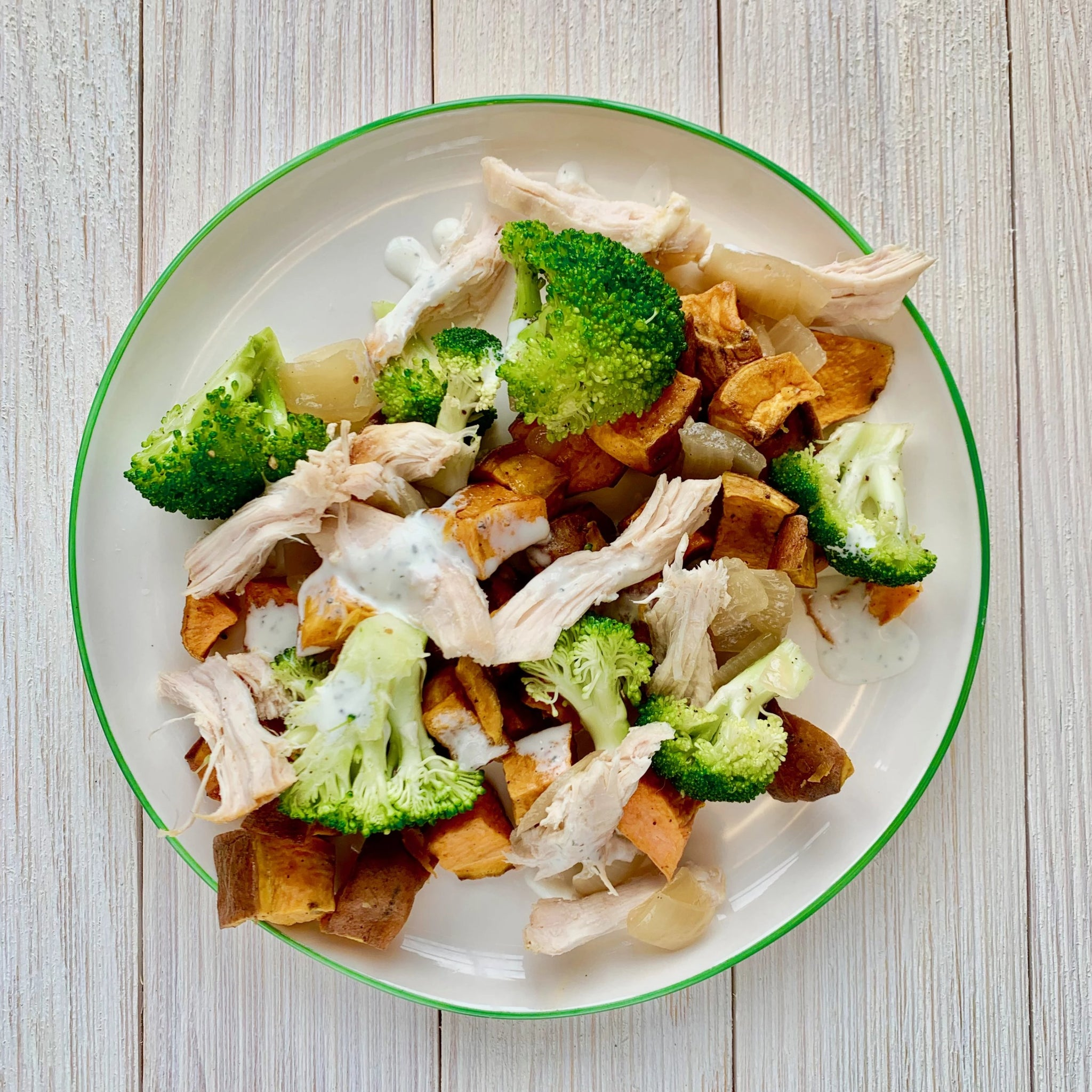Roasted Sweet Potato Bowl with Chicken, Broccoli, Caramelized Onions and Herb Cream