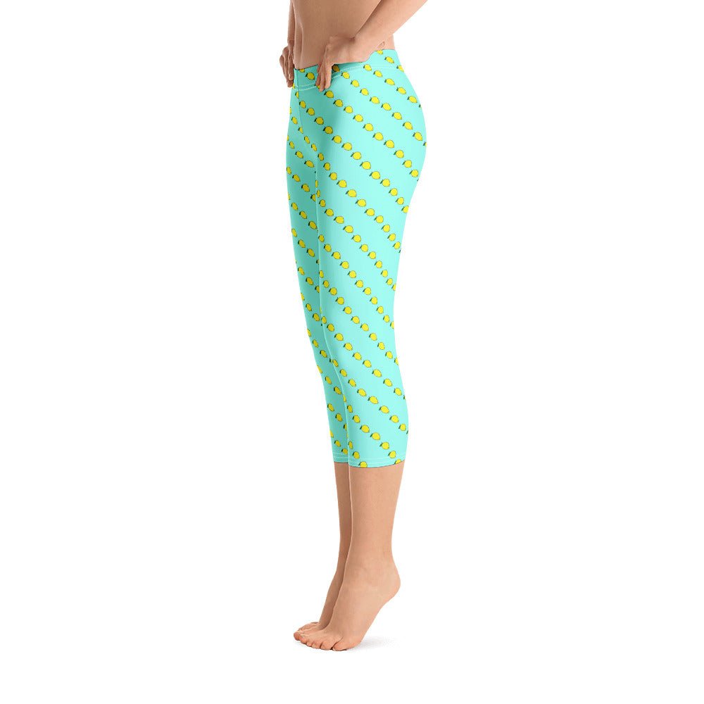 Mint colored women's capri leggings with fruity yellow lemon print. Workout Leggings by Florida Mode.