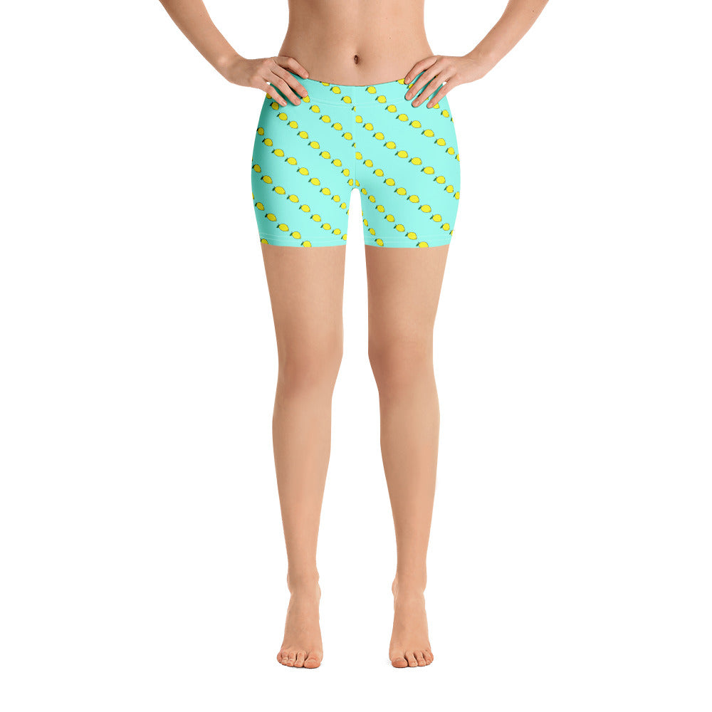 Mint gym shorts with fruity yellow lemon print. Workout Shorts by Florida Mode.