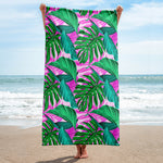 Pink palm leaves beach towel