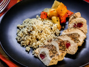 Apple and Cranberry Stuffed Chicken Breast with Wild Rice Pilaf and Roasted Vegetable Medley