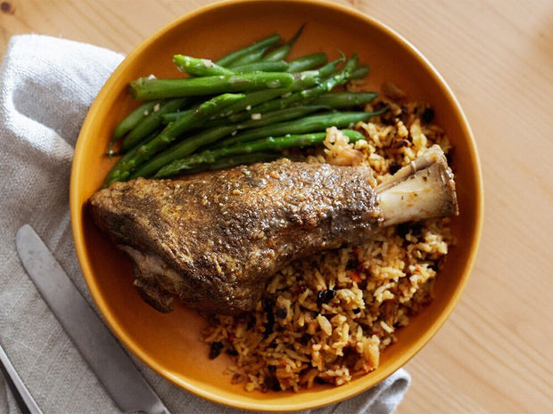 Braised Persian Lamb Shank Dinner with Persian Jeweled Rice, Sautéed Asparagus and Green Beans