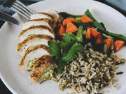 Asparagus-Chèvre Stuffed Chicken Breast with Wild Rice Pilaf and Seasonal Vegetable Medley
