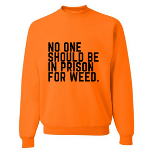 NO ONE SHOULD BE IN PRISON FOR WEED UNISEX SAFETY ORANGE SWEATSHIRT