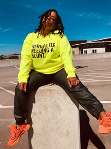 NORMALIZE NEEDING A BLUNT UNISEX SAFETY GREEN SWEATSHIRT