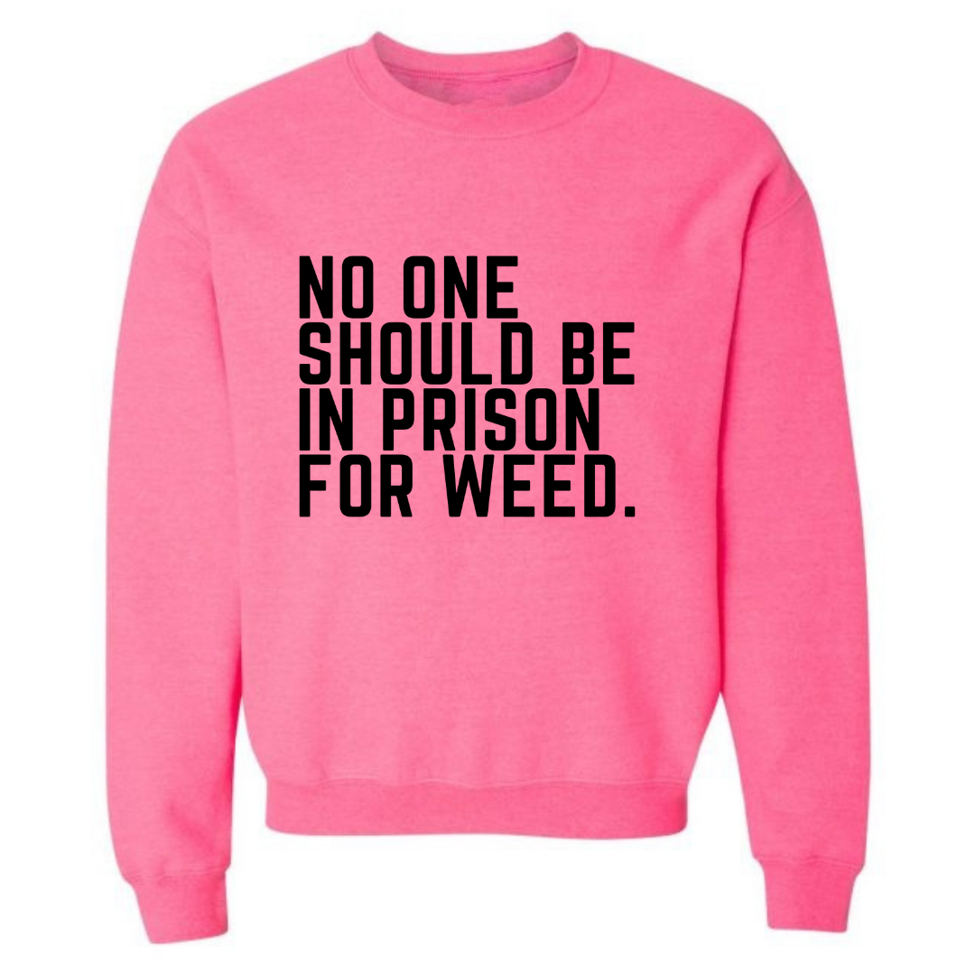 NO ONE SHOULD BE IN PRISON FOR WEED SAFETY PINK UNISEX SWEATSHIRT