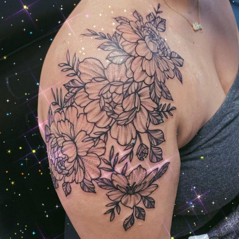 Whip shaded flower tattoo