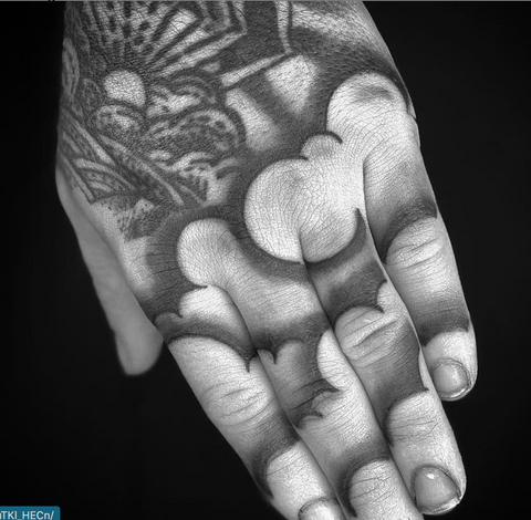 Hand and Finger Cloud Tattoo