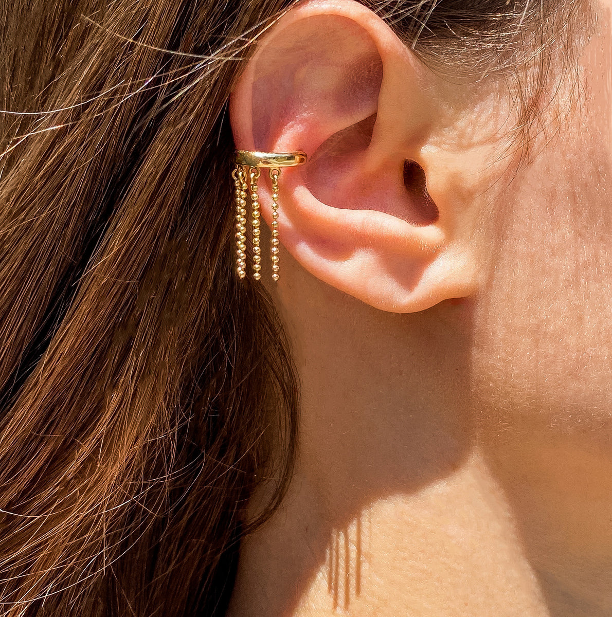 Tasseled ear cuff in 18K gold, Breeze collection
