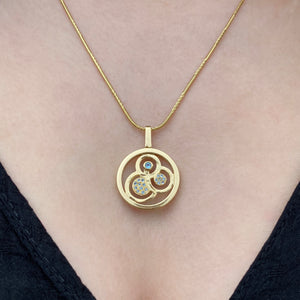 Swirl double sided pendant