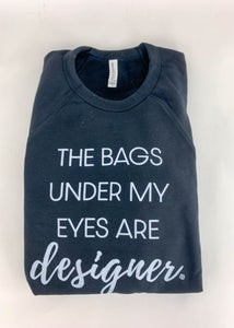 Bags under my eyes are designer pullover