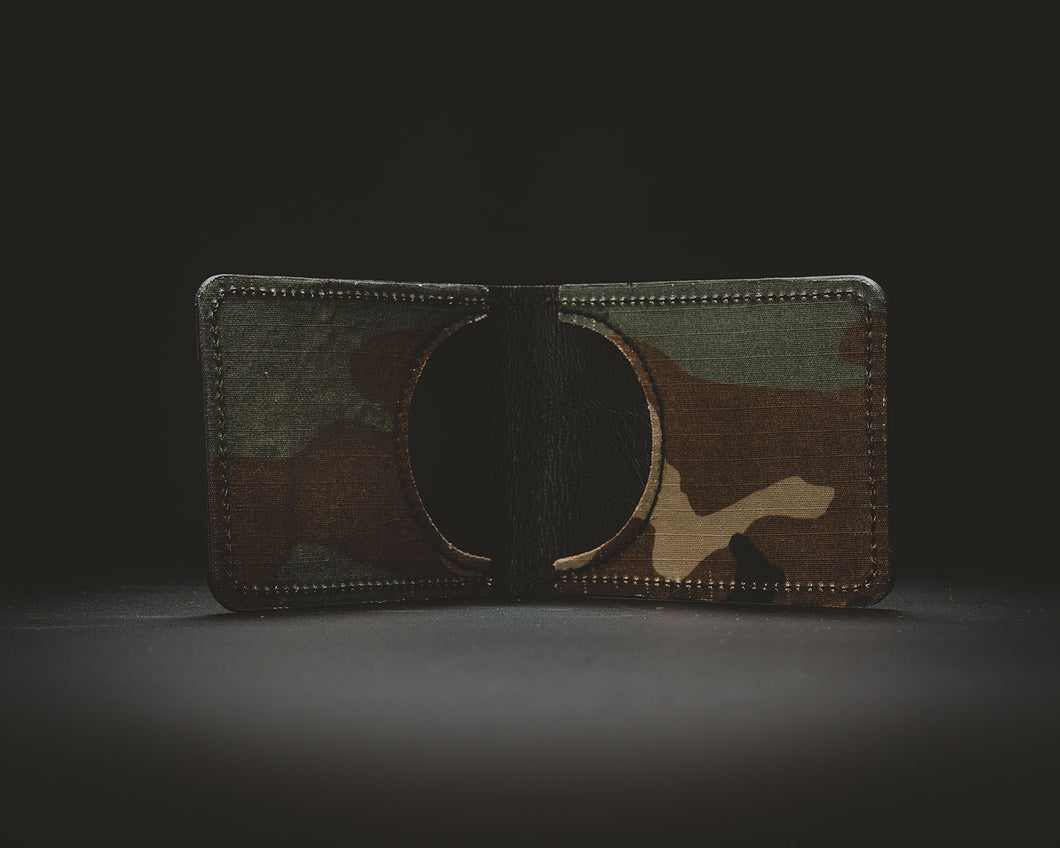 Woodland camo cordura and black leather wallet.